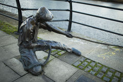 The Linesman statue at Liffey river. Stock Image
