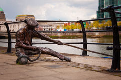 The linesman statue on River Liffey Stock Photos