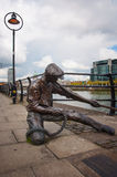 The linesman statue on River Liffey Royalty Free Stock Image