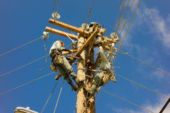 Linesmen at work on bequia in the windward islands Stock Image