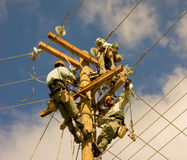 Linesmen at work on bequia in the windward islands Stock Photo