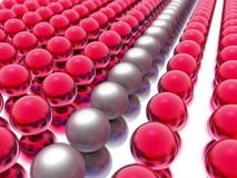 The Lineup. Rows and rows of spheres lined up with an odd row out Stock Photography