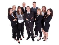 Lineup of business executives or partners. Lineup of diverse professional business executives or partners standing relaxed in a row isolated on white stock photography