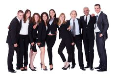 Lineup of business executives or partners. Lineup of diverse professional business executives or partners standing relaxed in a row isolated on white royalty free stock image