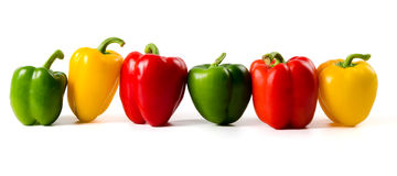 A lineup of colored peppers Royalty Free Stock Image