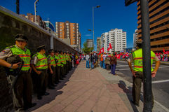 Lineup of ecuadorian policemen supervising Royalty Free Stock Photography