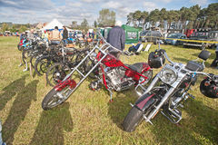 Lineup of motorbikes and bicycles. Lineup of motorbikes and bikes at Roseisle Vintage Rally held on 23rd September 2012 near Burghead in Morayshire Royalty Free Stock Photo