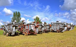 Lineup of old threshing machines Royalty Free Stock Image