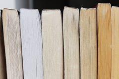 Lineup of paperback novels stock photos