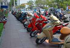 Lineup of Scooters on Pavement outside Majestic Hotel Royalty Free Stock Images
