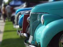 Lineup van uitstekende auto's stock fotografie