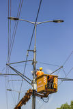Lineworkers work on overhead power line Royalty Free Stock Photo
