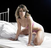 Lingerie dressed woman on bed Royalty Free Stock Photography