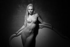 In lingerie on gray background. Royalty Free Stock Image