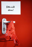 Lingerie hanging on a red door Stock Image