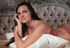 Lingerie Model Leans on Pillow Royalty Free Stock Images