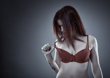Lingerie model pulling off bra Stock Image