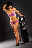 Lingerie model by the speaker Stock Photos