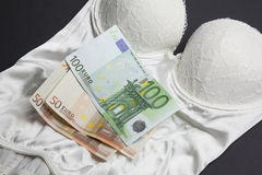 Love or money - Lingerie and money concept Royalty Free Stock Photography