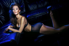 Lingerie s'usante de fille attirante Photographie stock libre de droits