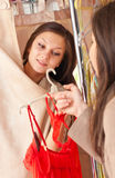 Lingerie Shop & Two Happy Women in changing room Royalty Free Stock Photos