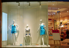 dress shop window with female mannequin   Royalty Free Stock Image