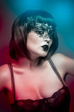 Lingerie woman, beautiful young in a black mask Royalty Free Stock Photos