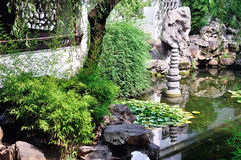 Lingering Garden lotus pond. Lingering Garden Park building layout ingenious, numerous and well-known stone. One of the four famous gardens in Chinese Stock Image
