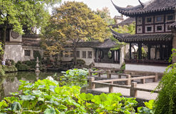 Lingering Garden in Suzhou China. A lotus pond surrounded by Chinese style buildings at The Lingering Garden in Suzhou China in Jiangsu Province stock photo