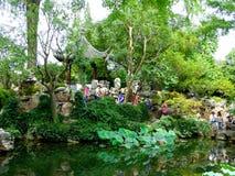 Lingering Garden view. Tourists traveling Lingering Garden that belong The Classical Gardens of Suzhou jiangsu province China Royalty Free Stock Image