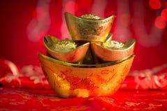 Lingotes chinos del oro de las decoraciones del Año Nuevo Fotos de archivo libres de regalías