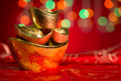 Lingotes chinos del oro del objeto del Año Nuevo con el espacio de la copia Imágenes de archivo libres de regalías