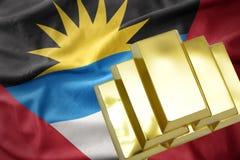 Lingotes de oro brillantes en la bandera de Antigua y de Barbuda Foto de archivo