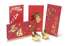 Lingotes del oro y paquetes rojos Fotos de archivo