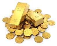 Lingotes e moedas do ouro Foto de Stock