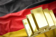 Lingots d'or brillants sur le drapeau de l'Allemagne Images libres de droits