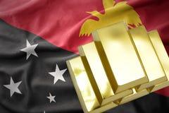 Lingots d'or brillants sur le drapeau de la Papouasie-Nouvelle-Guinée Photo libre de droits