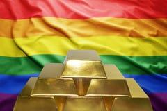 Lingots d'or sur le fond gai de drapeau Photo stock