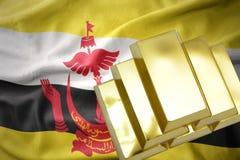 Lingotti dorati brillanti sulla bandiera del Brunei Immagini Stock Libere da Diritti