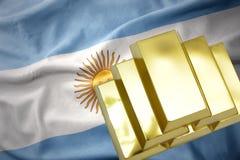 Lingotti dorati brillanti sulla bandiera dell'argentina Fotografie Stock Libere da Diritti