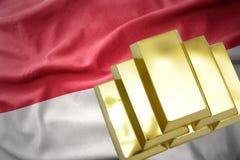 Lingotti dorati brillanti sulla bandiera dell'Indonesia Fotografie Stock