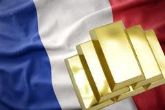 Lingotti dorati brillanti sulla bandiera della Francia Immagini Stock Libere da Diritti