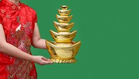 Lingotto cinese dell'oro del nuovo anno sullo schermo verde, Fotografia Stock