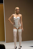Lingrie Expo Fashion Show Young woman in white stockings and lingerie Autumn Stock Photography