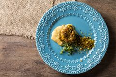 Linguado fish with mashed banana from the ground and farofa. Linguado fish with mashed banana from the ground and farofa Royalty Free Stock Photography