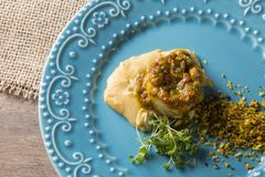 Linguado fish with mashed banana from the ground and farofa. Linguado fish with mashed banana from the ground and farofa Royalty Free Stock Photo