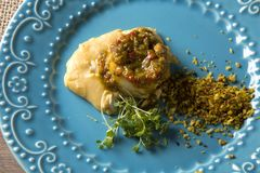 Linguado fish with mashed banana from the grund and farofa. Linguado fish with mashed banana from the ground and farofa Stock Image