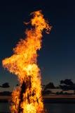 Lingue della fiamma al tramonto Immagine Stock