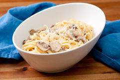 Linguine alfredo with mushrooms Stock Images