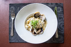 Linguine alla vongole bianco. Italian Cuisine , Clam sauce pasta Stock Photo